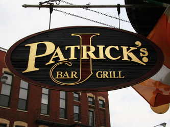 Image of sandblasted blade sign for J Patrick's in Chicago,IL