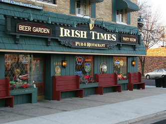 Image of the Irish Times Pub and Restaurant Wooden Sign in Brookfield,IL by the Wooden Sign Company