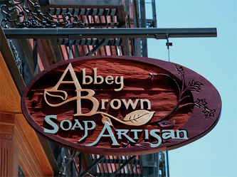 Image of the Wooden Sign Company's Wood Blade Sign for Abbey Brown Soap Artisan in Chicago's Old Town Neighborhood