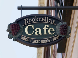 Image of the Wooden Sign Company's Bookcellar Cafe Hanging blade sign in Chicago,IL