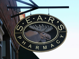 Image of the Wooden Sign Company's Sears Pharmacy Sign in Oak Park, IL