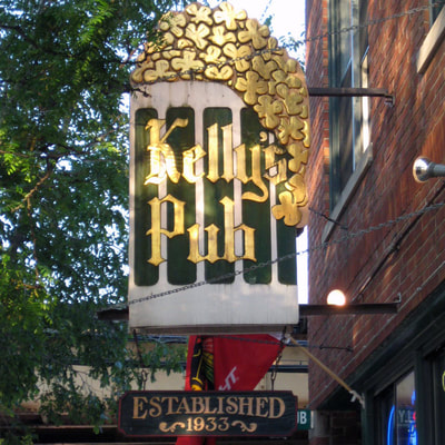 Image of Carved, sandblasted and gold leafed wooden sign for Kellys Pub Lincoln Park Chicago, IL