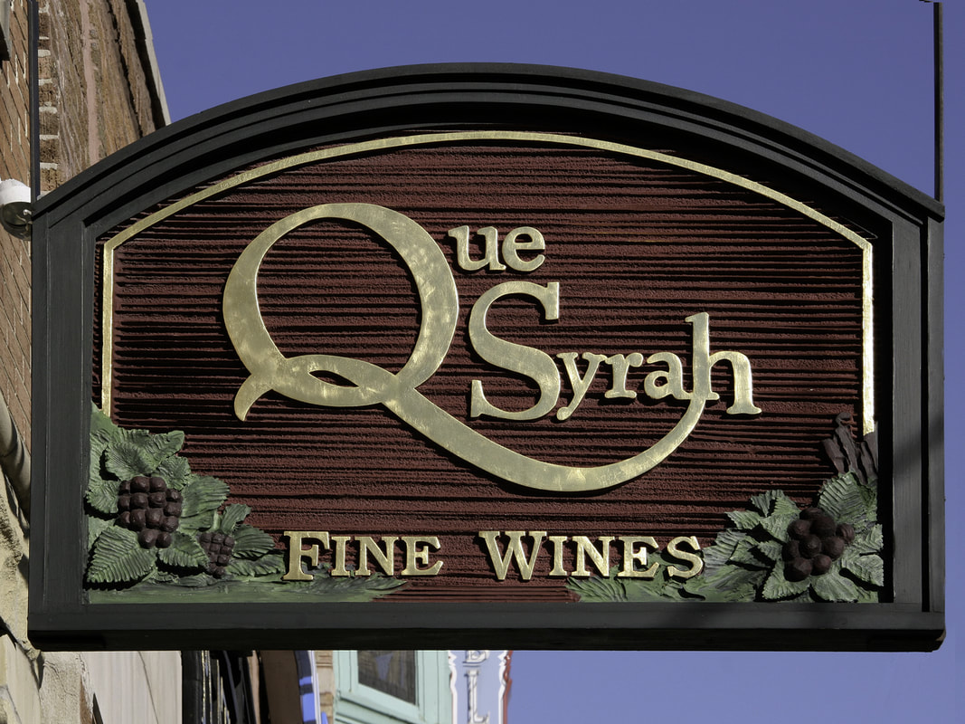 image of que syrah wine sign wells street old town signs chicagoil